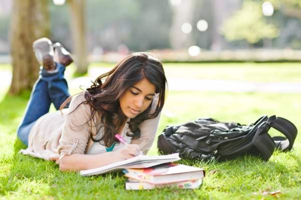 Woman-Studying-on-grass